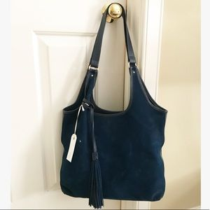 Leather trimmed suede hobo by Gigi New York